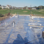 Concrete slab with vapor barrier insulation